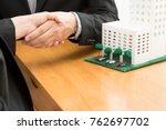 customer shakes hands and... | Shutterstock . vector #762697702