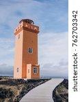 orange lighthouse on the black... | Shutterstock . vector #762703342