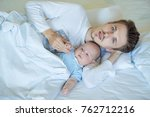 father and little newborn son... | Shutterstock . vector #762712216