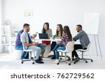 young business people work in a ... | Shutterstock . vector #762729562