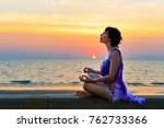 the girl is meditating on the... | Shutterstock . vector #762733366