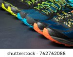 three pairs of colorful running ... | Shutterstock . vector #762762088