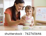 mother and kid daughter doing... | Shutterstock . vector #762765646