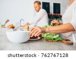 couple on kitchen cooks together | Shutterstock . vector #762767128
