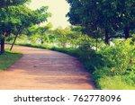 walk path in the garden. blur... | Shutterstock . vector #762778096