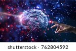 hand touching brain and... | Shutterstock . vector #762804592