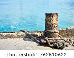 old iron dock cleat in dock.... | Shutterstock . vector #762810622