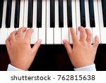 girl playing piano. closeup... | Shutterstock . vector #762815638