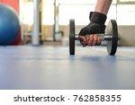 hand holding dumbbell on the... | Shutterstock . vector #762858355