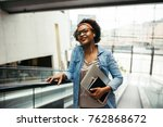 smiling young african female... | Shutterstock . vector #762868672