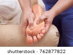 the doctor podiatrist does an... | Shutterstock . vector #762877822