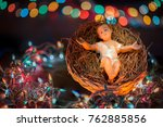 Small photo of concept Happy Christmas and New Year. Christmas Manger scene with figurines including Jesus, Mary, Joseph, magi with wonderful bokeh background. Baby birth at holy night on the straw in menagerie.