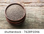 heap of chia seeds in bowl on... | Shutterstock . vector #762891046