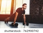 man doing pushups at the gym | Shutterstock . vector #762900742