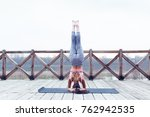 young woman practicing yoga in... | Shutterstock . vector #762942535