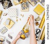 female hands holding champagne... | Shutterstock . vector #762943462