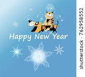 Stock vector new year greeting card with dog and cat on blue background with snowflakes 762958552