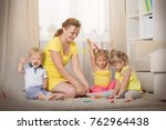 mom plays with children twins... | Shutterstock . vector #762964438