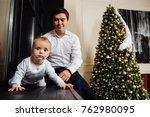 father and child play christmas.... | Shutterstock . vector #762980095