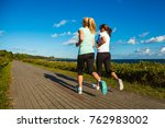 middle aged woman running at... | Shutterstock . vector #762983002