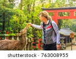 young male tourist feeds with... | Shutterstock . vector #763008955