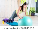 fit woman doing push ups with... | Shutterstock . vector #763011316