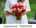 bride in white dress holding in ... | Shutterstock . vector #763023505