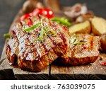 grilled fillet steaks on wooden ...   Shutterstock . vector #763039075