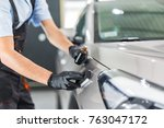 car detailing   man applies... | Shutterstock . vector #763047172