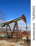 Rusty Pump Jack In Spring  Usa...