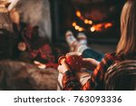 feet in woollen socks by the... | Shutterstock . vector #763093336