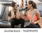 cheerful young man and woman... | Shutterstock . vector #763094395