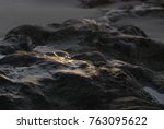 dark background with stones on... | Shutterstock . vector #763095622
