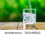 a glass of water on green... | Shutterstock . vector #763148062