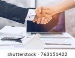 banker and client shaking hands ... | Shutterstock . vector #763151422