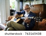 An Elderly Man Is Playing Guitar