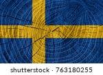 Sweden Flag On Wood Texture...