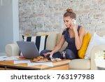 female freelancer in her casual ... | Shutterstock . vector #763197988