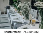 wedding table decorated with... | Shutterstock . vector #763204882