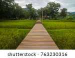 wooden walk way through paddy... | Shutterstock . vector #763230316