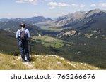 Hiker In Mountain Landscape...
