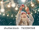 happy child playing on a snowy... | Shutterstock . vector #763284568
