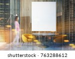 woman in a gray and wooden...   Shutterstock . vector #763288612