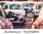 Cars Side by Side Parking Space Theme. Tight City Parking Full of Cars. - stock photo
