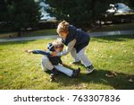 boys fighting in the park | Shutterstock . vector #763307836