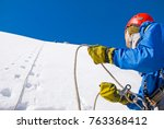 climber with backpacks reaches... | Shutterstock . vector #763368412