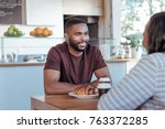 young african couple sitting at ... | Shutterstock . vector #763372285