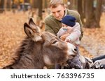 father with little daughter in... | Shutterstock . vector #763396735