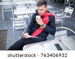 serious young freelancer... | Shutterstock . vector #763406932