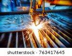 oxygen torch cuts steel sheet.... | Shutterstock . vector #763417645